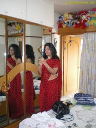 Sexy Wife Doing makeup in Red Saree Pics